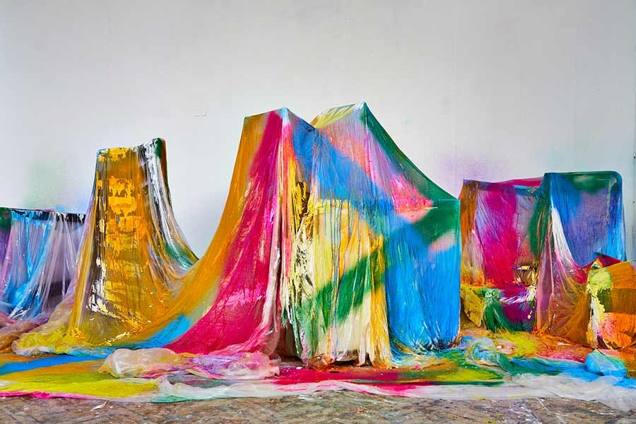 Fine Art installation: blocks covered in sheets spray painted in bright colours
