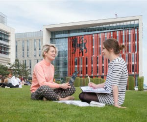 students on the grass in front of Curzon