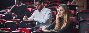 Event, Venue and Experience Management BA (Hons) Course Image 1200x450 - Woman sat in a theatre style classroom