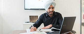 Executive MBA Image 341x139 - Man at a desk