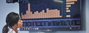 Finance and Investment Course Image 1200x450 - Woman looking at financial data