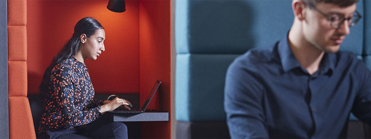Finance and Investment MSc Course Image 1200x450 - Woman sat at a desk with a laptop