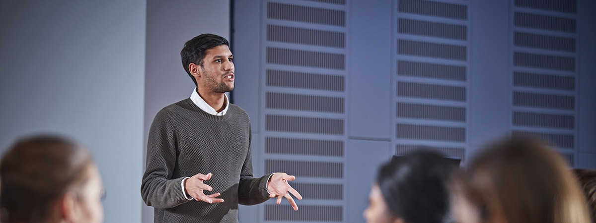 Foundation Programme in Business Course Image 1200x450 - Man in front of a lecture theatre
