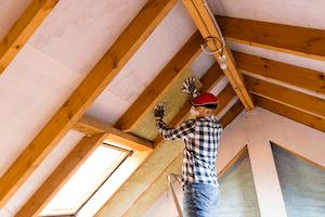 Photo of builder installation roof insulation