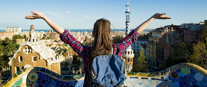 Backpacker looks out over city