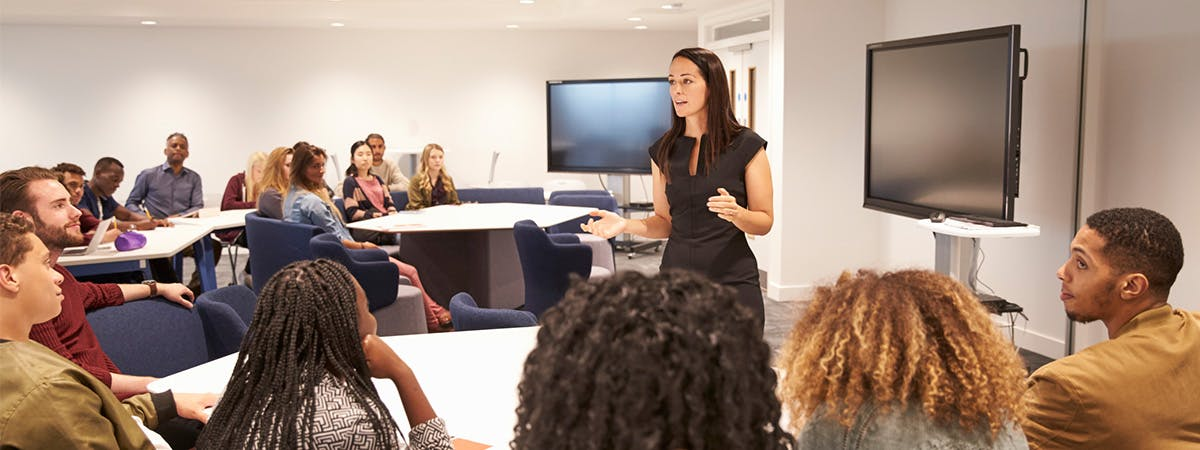 A young lecturer teaching a university class.