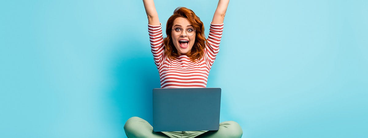 How to succeed with online learning 1200x450 - Woman on a laptop cheering