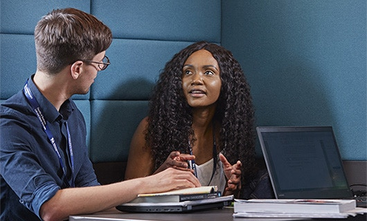 Business School - News - ATD - In-Depth Information Image 530x320 (Man and woman talking at a desk)