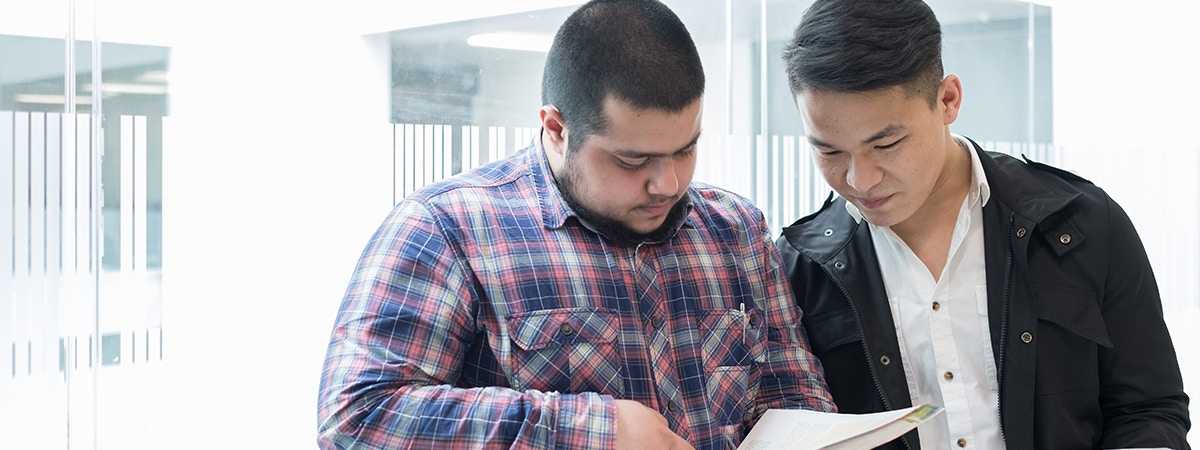 Innovation Management MA Course Image 1200x450 - Two men looking at a textbook