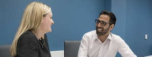 Management Consultancy Course Image 2 1200x450 - Man and woman talking at a table