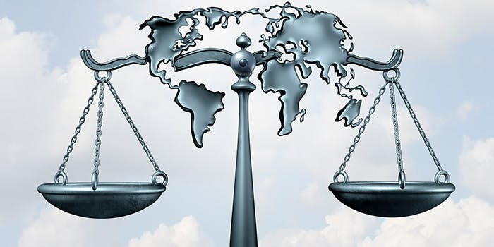International Mobility 700x350 - Scales of justice with a map of the world on it