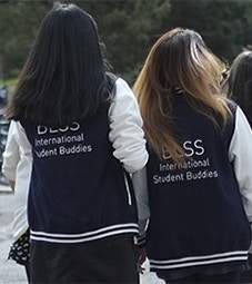International Student Buddies Flip Card Image 227x255 - Two student buddies in Letterman jackets