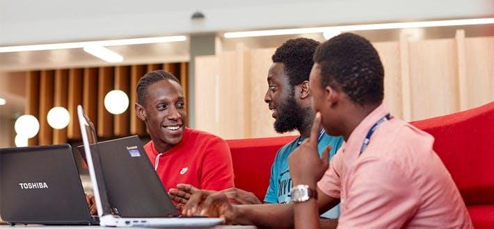 Students around laptops