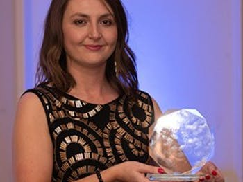Jenna Langford holding award from RTPI