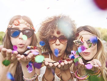 BLSS July Whats On Guide Image 350x263 - Three women blowing confetti at the camera