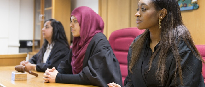 Group of law students in lock court room