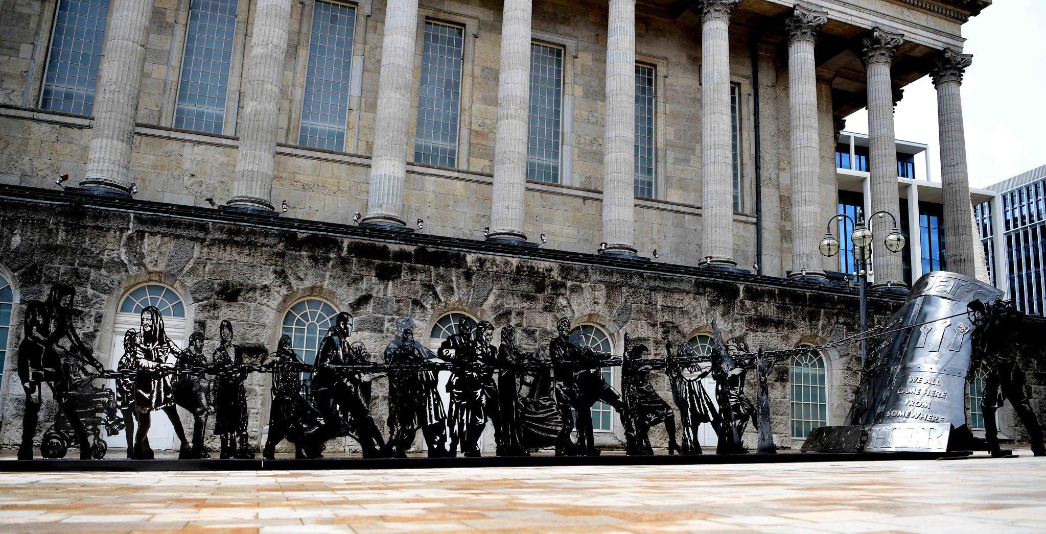 Image of Birmingham city centre art installation, featuring black metal sculptures
