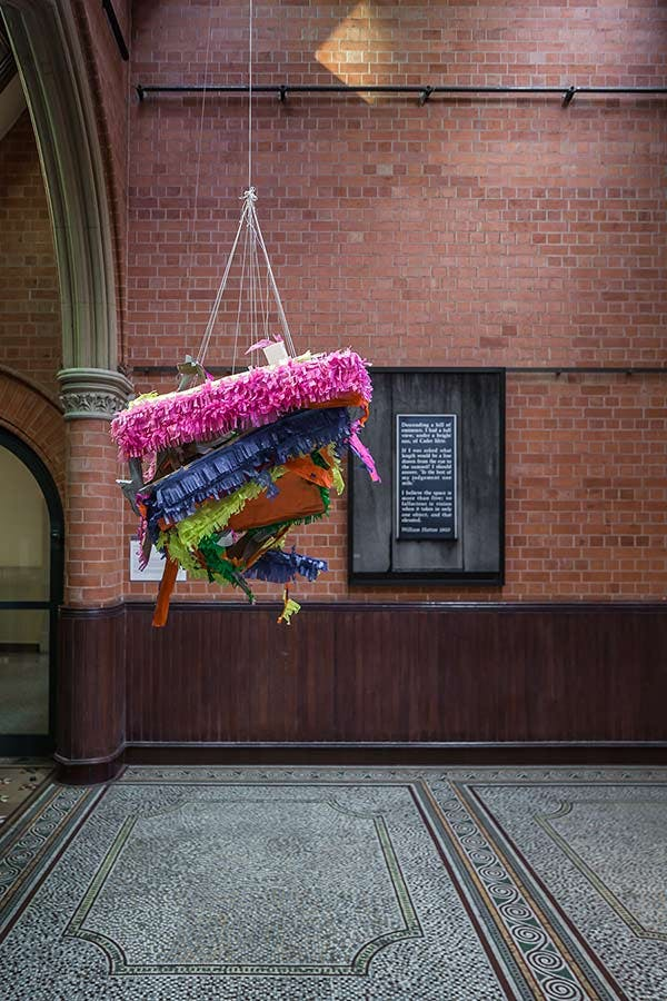 Margaret Street Atrium with large piñata type sculpture hanging from ceiling