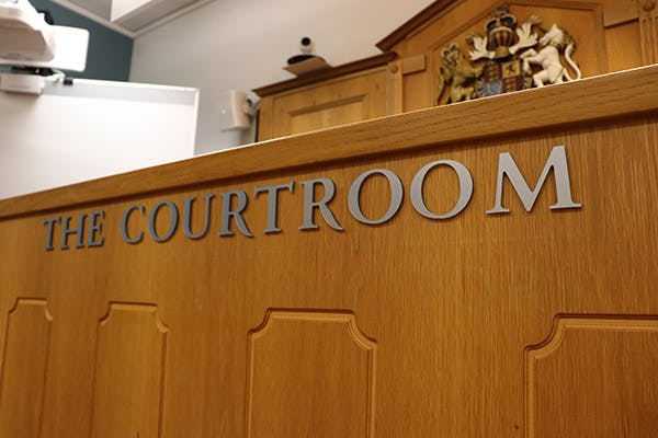 Magistrates Court 2 600x400 - close up of logo