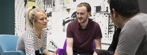 Marketing - BA (Hons) Course Image 1200 x 450 - Men and women in a meeting