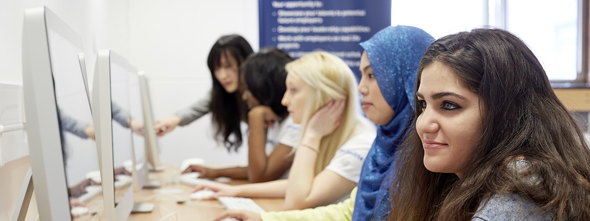 Marketing (Digital Media and Technology) - BA (Hons) Course Image 1200x450 - Women sat at a computer bank