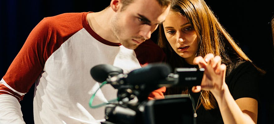 Media students using camera equipment