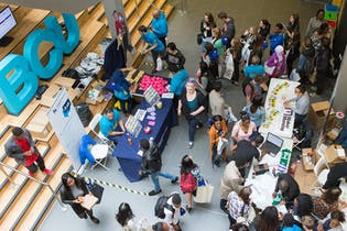 Image of students in hall meeting with employers
