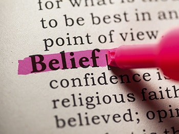 Pen highlights 'Belief' in dictionary
