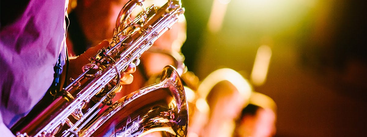 A musician playing saxophone.