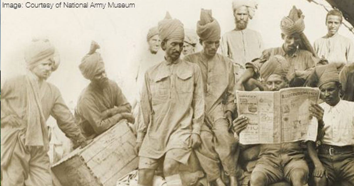 Muslim soldiers reading the news small