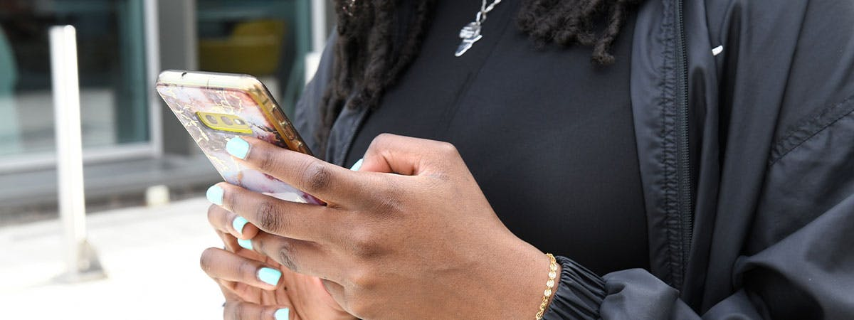 Student using phone on campus