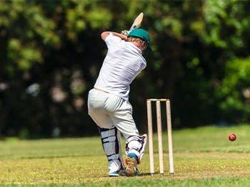 Cricket player striking a wicket