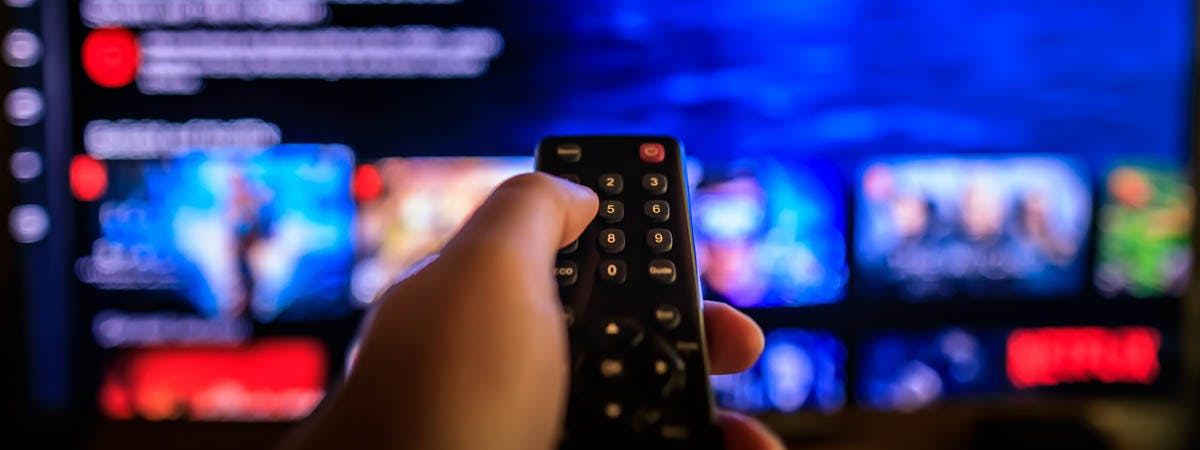 Netflix Entrepreneur Article 1200x450 - Remote in front of a TV screen showing Netflix