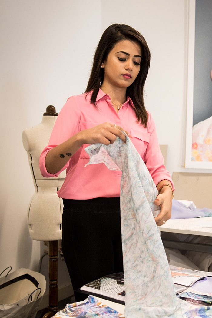 MA student Nivi Krishnan working with textiles