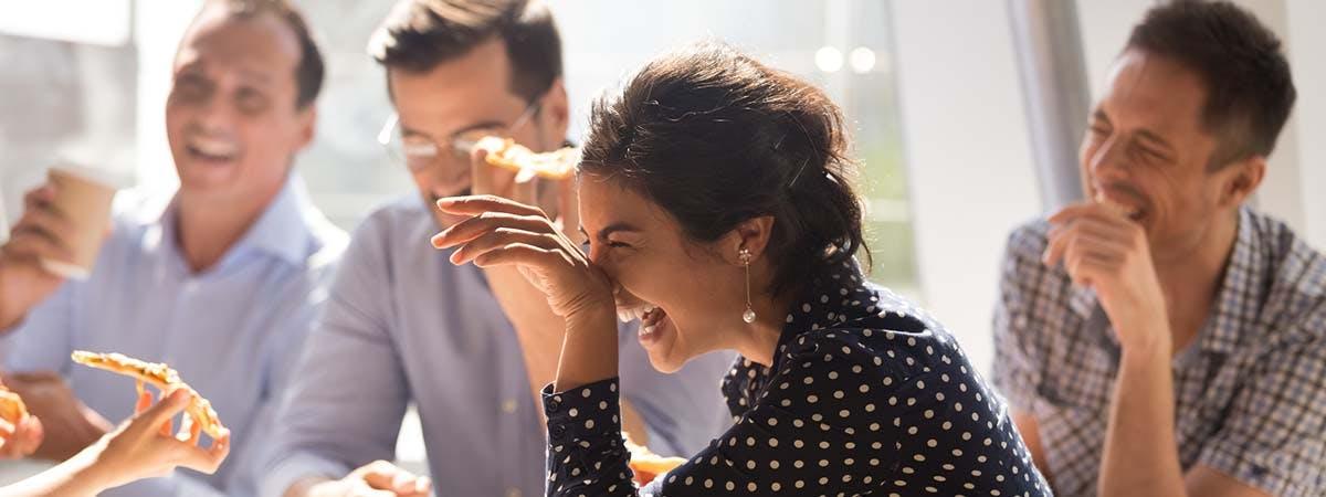 Organisational Behaviour 1200x450 - People laughing