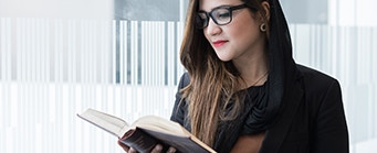CLSP Our Student Research Community Image 341x139 - Woman reading a book