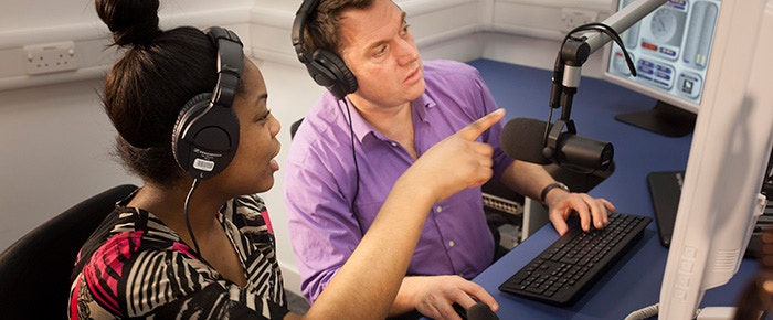 Sam Coley with a student. Radio bursaries for community radio workers.