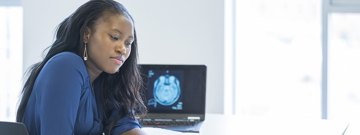 Psychology with Criminology - BSc (Hons) Course Image 1200 x 450 - Woman at a computer