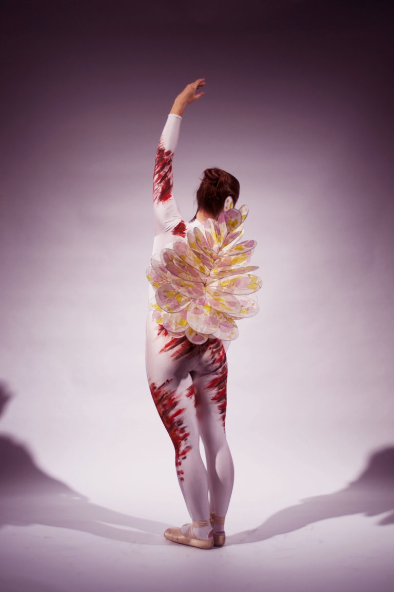 A sculptural costume design for a contemporary ballet performance, resembling open mindedness