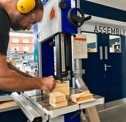 Man using woodworking machinery