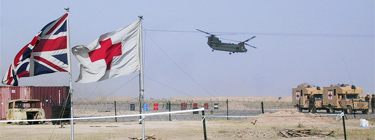 BCU Health defence scene featuring Chinook and flags.
