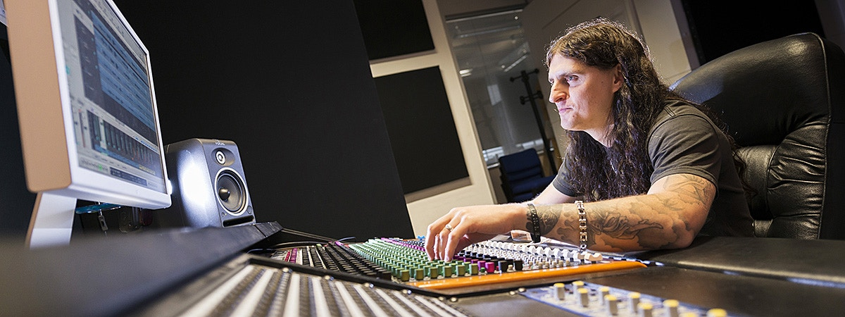 BCU DMT sound engineering student in a studio.