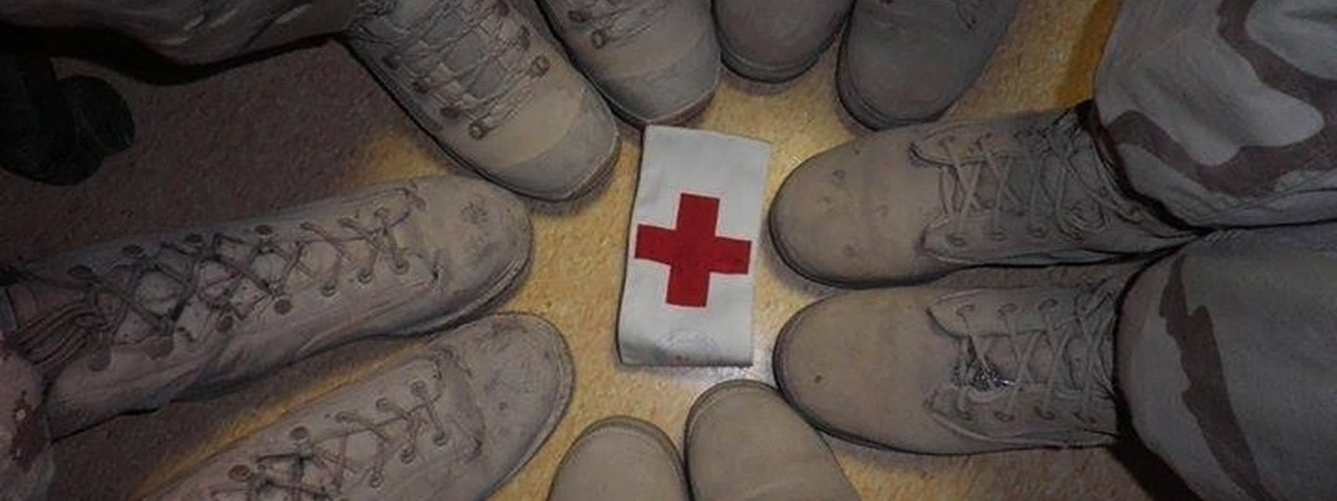 BCU Health defence with boots circled around a red cross emblem.