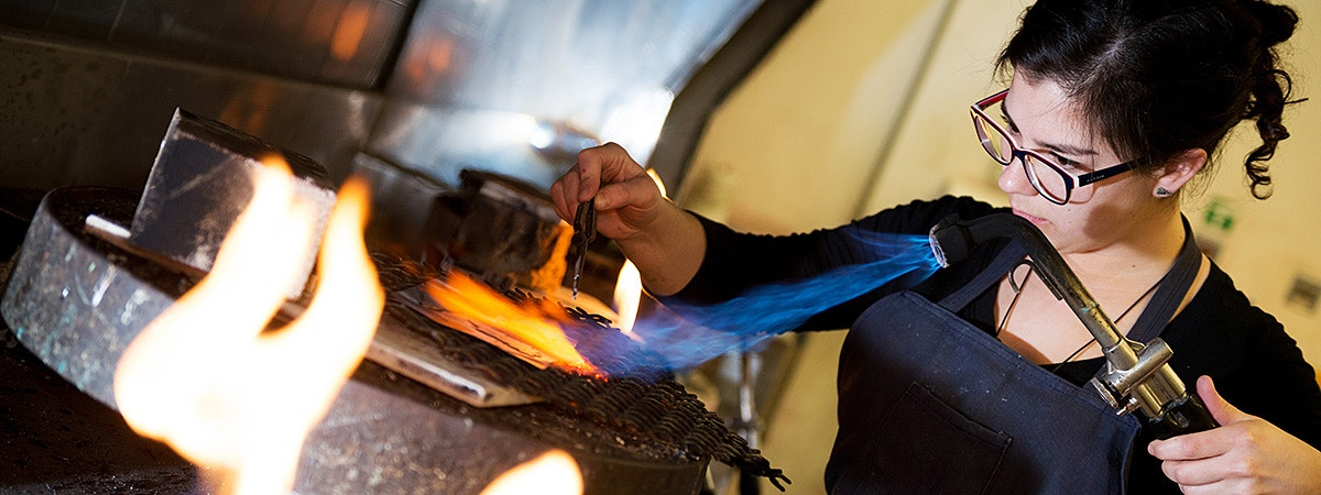 BCU Jewellery student using a blow torch.