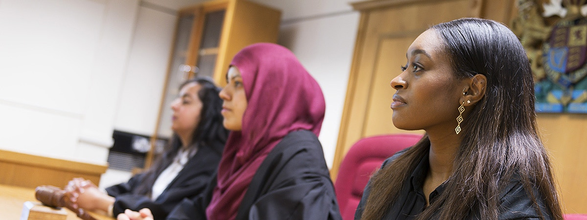 BCU Law students acting as judges in mock courtroom.