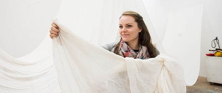 BCU Art student with white fabric.