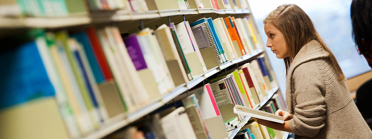 BCU English student in a library.