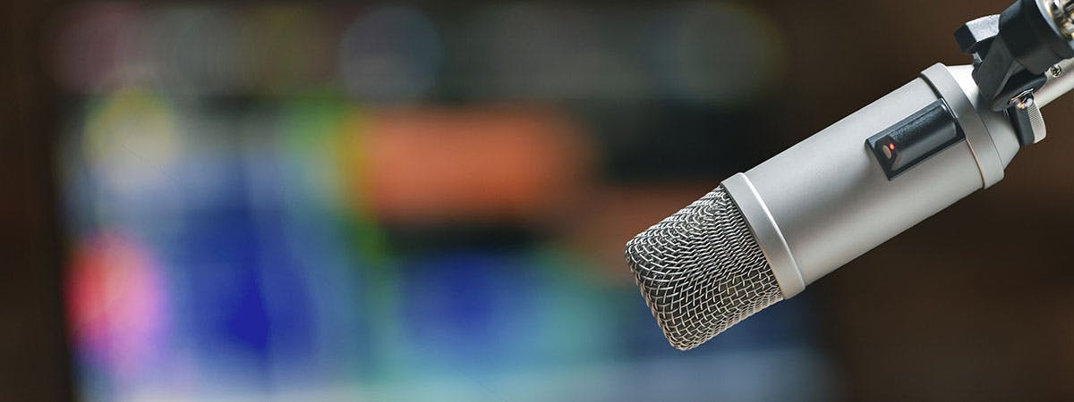 True Crime Podcast Article 1200x450 - Microphone with a laptop in the background