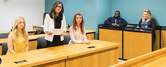 CLSP Undergraduate Opportunities Image 341x139 - Students stood in a court room