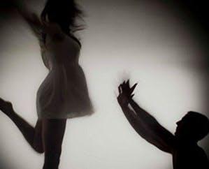 dramatic ballet dancers. male dancer pushes away female dancer